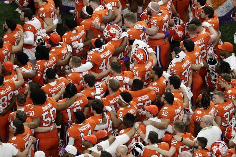 Clemson leaves the field after their loss against LSU in a NCAA College Football Playoff national championship game Monday, Jan. 13, 2020, in New Orleans. (AP Photo/Eric Gay)