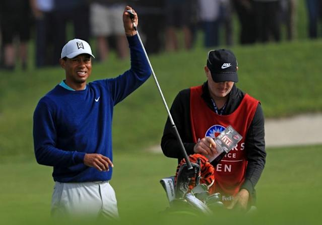 Florida man suing Woods, caddie over alleged shove at 2018 tournament
