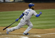 FILE - In this Aug. 29, 2014, file photo, Los Angeles Dodgers' Hanley Ramirez follows through after hitting an RBI-double against the San Diego Padres during the third inning in a baseball game in San Diego. The Boston Red Sox expect to finalize the signing of Ramirez on Tuesday, Nov. 25, 2014. (AP Photo/Gregory Bull, file)