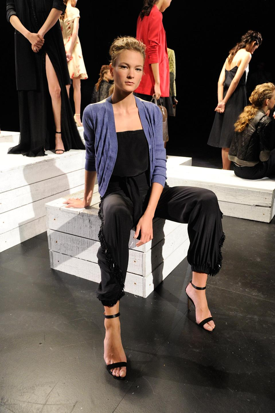 """<div class=""""caption-credit""""> Photo by: Kevin Mazur/WireImage/Getty</div>The collection's silk jumpsuits and silk-lined blazers will likely appeal to a new set of ladies who lunch--working moms who get their food to go. The minimalist, contemporary separates are low-drama, high-fashion and easy to pull together in a pinch. <br>"""