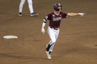 Mississippi State infielder Kellum Clark (11) runs the bases after hitting a homer in the eighth inning with Scott Dubrule also scoring against Virginia during a baseball game in the College World Series Tuesday, June 22, 2021, at TD Ameritrade Park in Omaha, Neb. (AP Photo/John Peterson)