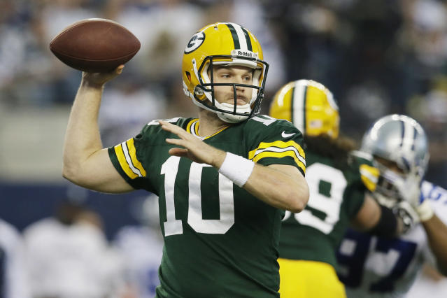 Green Bay Packers quarterback Matt Flynn (10) passes against the Dallas Cowboys during the first half of an NFL football game, Sunday, Dec. 15, 2013, in Arlington, Texas. (AP Photo/Tony Gutierrez)