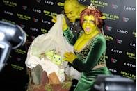 <p>If you couldn't tell that Heidi Klum and her boyfriend, Tom Kaulitz, were hiding behind these green ogre costumes, you're not alone. Dressed as Princess Fiona and Shrek, you'd never guess the stunning supermodel and her man are hiding under all that green paint at her own Halloween party. (Well done, Heidi, well done.) </p>