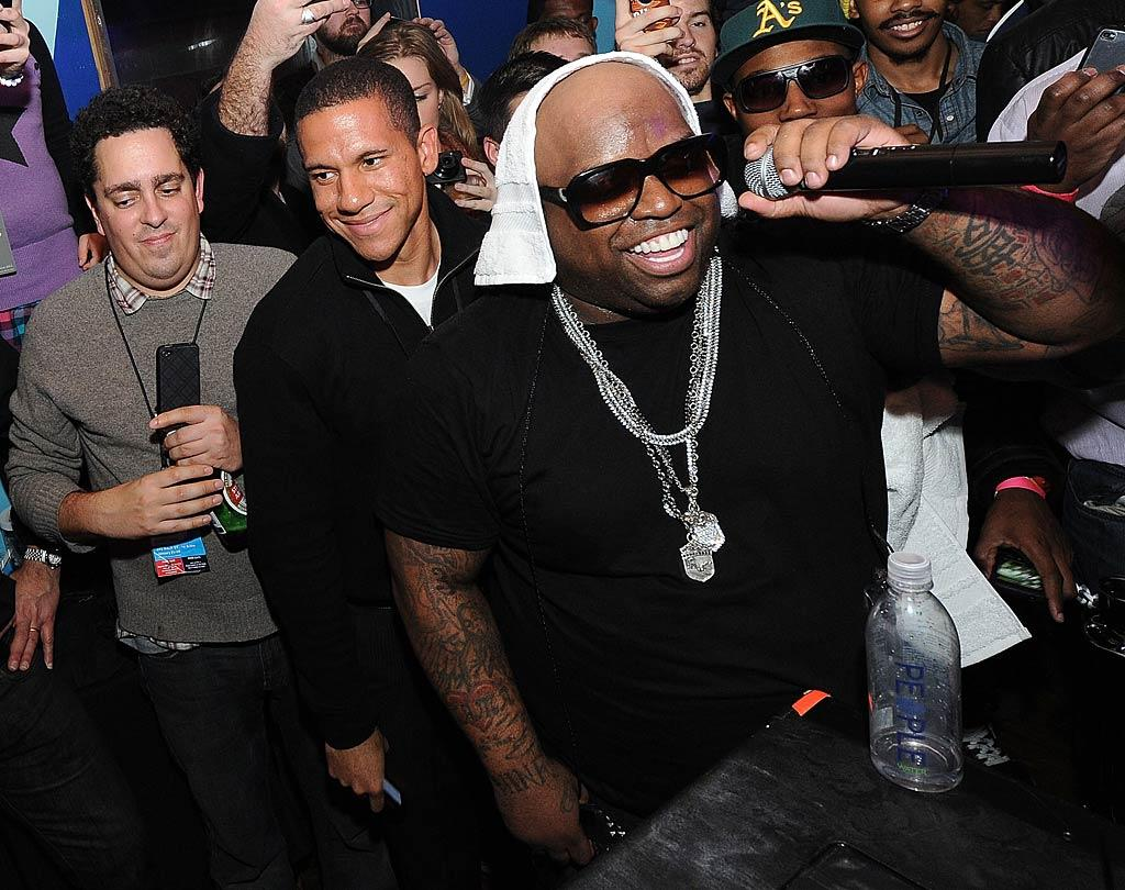 """Cee Lo Green worked up a sweat while performing at the Bing Lounge, where he jumped offstage and danced with the crowd while performing his hit single """"F--- You."""" Michael Buckner/<a href=""""http://www.gettyimages.com/"""" target=""""new"""">GettyImages.com</a> - January 23, 2011"""