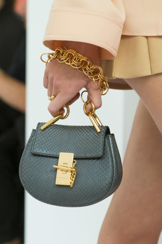 <p><i>Teal mini bag with gold chain from the SS18 Chloé collection. (Photo: ImaxTree) </i></p>