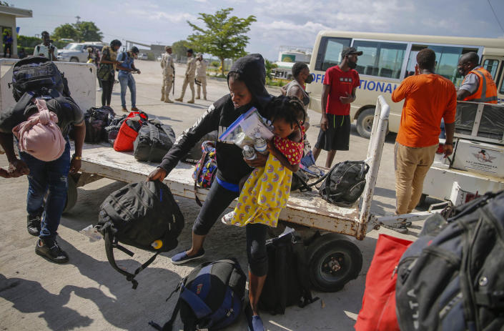 Haitians who were deported from the United States arrive at the Toussaint Louverture International Airport, in Port au Prince, Haiti, Sunday, Sep. 19, 2021. Thousands of Haitian migrants have been arriving to Del Rio, Texas, to ask for asylum in the U.S., as authorities begin to deported them to back to Haiti. (AP Photo/Joseph Odelyn)