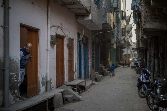 Muhammad Nasir Khan, who was shot by a Hindu mob during the February 2020 communal riots, looks out from his home in North Ghonda, one of the worst riot affected neighborhood, in New Delhi, India, Friday, Feb. 19, 2021. As the first anniversary of bloody communal riots that convulsed the Indian capital approaches, Muslim victims are still shaken and struggling to make sense of their struggle to seek justice. (AP Photo/Altaf Qadri)