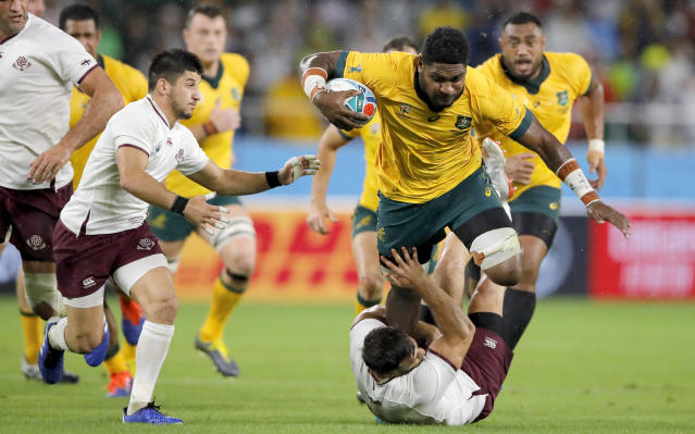 Australia's Isi Naisarani runs at the Georgian defence during the Rugby World Cup Pool D game at Shizuoka Stadium Ecopa between Australia and Georgia in Shizuoka, Japan, Friday, Oct.11, 2019. (AP Photo/Christophe Ena)