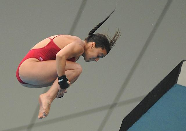 Canada's Meaghan Benfeito competes in the women's 10-metre platform final diving event in the FINA World Championships at the outdoor diving pool of the Oriental Sports Center, in Shanghai, on July 21, 2011. AFP PHOTO / MARK RALSTON (Photo credit should read MARK RALSTON/AFP/Getty Images)