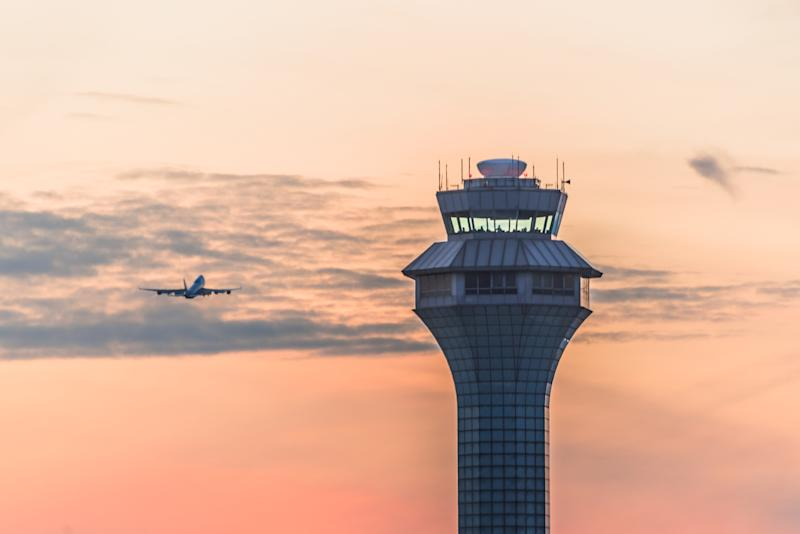 Airport traffic control tower at sunset