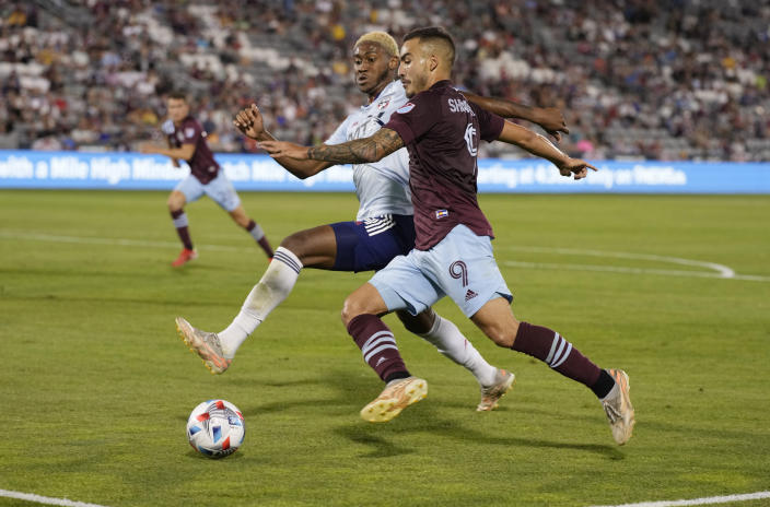 Colorado Rapids forward Andre Shinyashiki, front, moves the ball past FC Dallas defender Nkosi Burgess during the second half of an MLS soccer match Wednesday, July 21, 2021, in Commerce City, Colo. The Rapids won 2-0. (AP Photo/David Zalubowski)