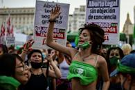 Abortion rights activists demonstrate outside the Argentine Congress as senators debate a landmark bill on whether to legalize abortion, in Buenos Aires, on December 29, 2020