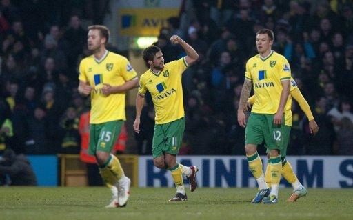 Norwich City's Andrew Surman (C) during a Premier League match on February 4. Norwich manager Paul Lambert is relishing the opportunity of facing Manchester United and says Norwich, who start the weekend in 8th spot after winning their last two league games, fear no one