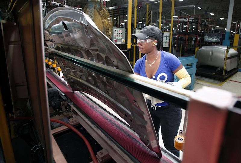A Fiat Chrysler worker is seen on the production line at the FCA Sterling Stamping Plant in Sterling Heights, Michigan (AFP Photo/Bill Pugliano)