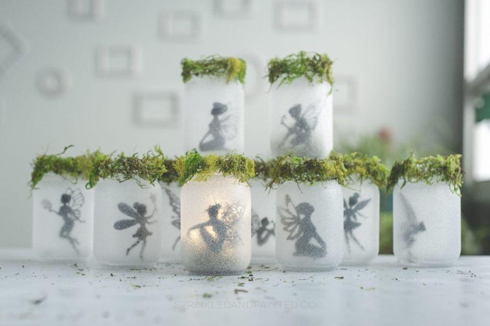"""<p>Make these fairy jars as a DIY craft before Easter, and you'll bring a little of the outdoors inside. Then, the fairies can help the Easter Bunny hide the eggs around the house. If your kids need an extra hint, the votive candles can offer a clue. And, since these don't scream """"Easter,"""" you can use them afterward for whatever fairy treasures your kids collect. (Or, if you like the idea of using mason jars but aren't into fairies, you can do the more traditional <a href=""""https://kastyles.co/glitter-easter-egg-mason-jars/"""" rel=""""nofollow noopener"""" target=""""_blank"""" data-ylk=""""slk:Easter egg"""" class=""""link rapid-noclick-resp"""">Easter egg</a> or<a href=""""https://kastyles.co/easter-mason-jars/"""" rel=""""nofollow noopener"""" target=""""_blank"""" data-ylk=""""slk:Easter bunny"""" class=""""link rapid-noclick-resp""""> Easter bunny</a>.)</p><p><em><a href=""""https://kastyles.co/glitter-fairy-mason-jars-with-moss/"""" rel=""""nofollow noopener"""" target=""""_blank"""" data-ylk=""""slk:Get the fairy jar tutorial at Sprinkled & Painted »"""" class=""""link rapid-noclick-resp"""">Get the fairy jar tutorial at Sprinkled & Painted »</a></em></p>"""
