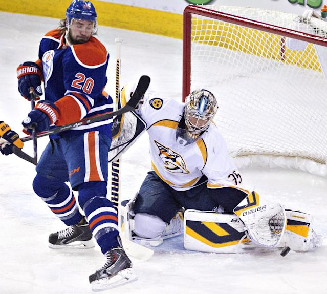 Nashville Predators goalie Pekka Rinne (35) makes the stop on Edmonton Oilers' Luke Gazdic (20) during the first period of an NHL hockey game Tuesday, March 18, 2014, in Edmonton, Alberta. (AP Photo/The Canadian Press, Jason Franson)