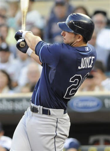 Tampa Bay Rays' Matt Joyce hits a two-run home run off Minnesota Twins pitcher Cole DeVries in the first inning of a baseball game on Friday, Aug. 10, 2012, in Minneapolis. (AP Photo/Jim Mone)