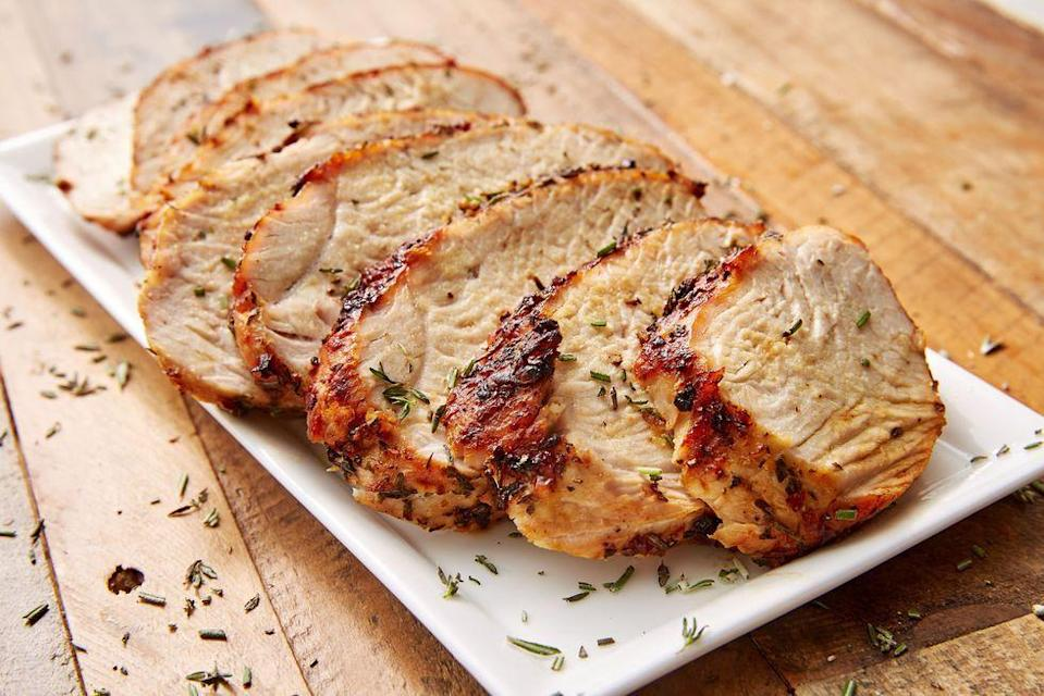 """<p>Quit stressing over a <a href=""""https://www.delish.com/uk/cooking/recipes/g29708845/christmas-turkey-recipe/"""" rel=""""nofollow noopener"""" target=""""_blank"""" data-ylk=""""slk:perfectly roasted turkey"""" class=""""link rapid-noclick-resp"""">perfectly roasted turkey</a> for Christmas. It's hard and it takes up all of your oven space. This year, make your turkey in the air fryer! It takes way less effort with far better results. </p><p>Get the <a href=""""https://www.delish.com/uk/cooking/recipes/a34665691/air-fryer-turkey-recipe/"""" rel=""""nofollow noopener"""" target=""""_blank"""" data-ylk=""""slk:Air Fryer Garlic Herb Turkey Breast"""" class=""""link rapid-noclick-resp"""">Air Fryer Garlic Herb Turkey Breast</a> recipe.</p>"""