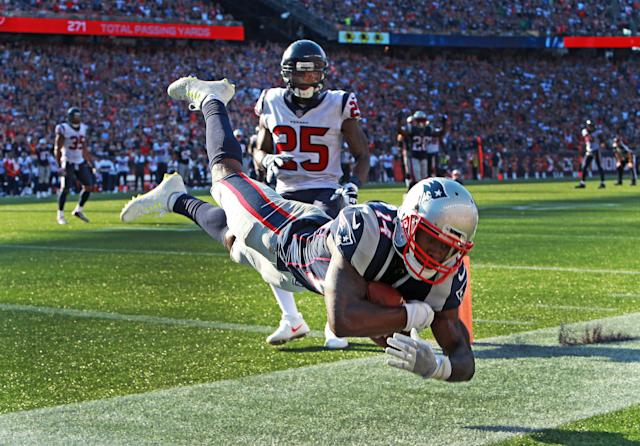 <p>New England Patriots wide receiver Brandin Cooks sails across the goal line as he stayed in bounds to make the game-winning touchdown late in the fourth quarter on a pass from quarterback Tom Brady during a game against the Houston Texans at Gillette Stadium in Foxborough, Mass., Sept. 24, 2017. (Photo by Jim Davis/The Boston Globe via Getty Images) </p>
