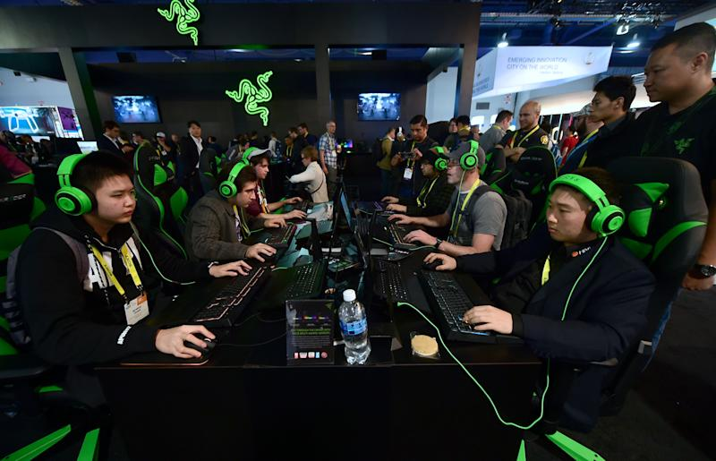 Gamers play 'Overland' by Blizzard using hardware from Razer during the 2017 Consumer Electronic Show (CES. Photo: FREDERIC J. BROWN/AFP via Getty Images