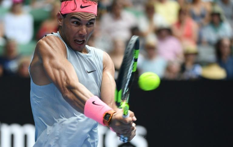 Spain's Rafael Nadal hits a return against Argentina's Diego Schwartzman during their men's singles match on day seven of the Australian Open in Melbourne on January 21, 2018