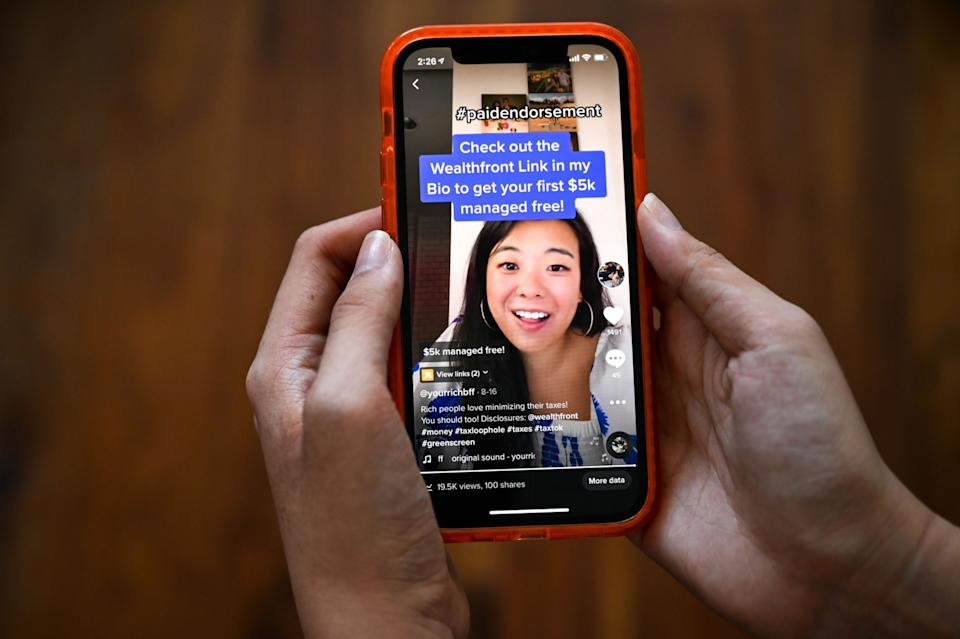 The YourRichBFF TikTok account displaying a paid endorsement by sponsor, Wealthfront. (PHOTO: Desiree Rios/Bloomberg)