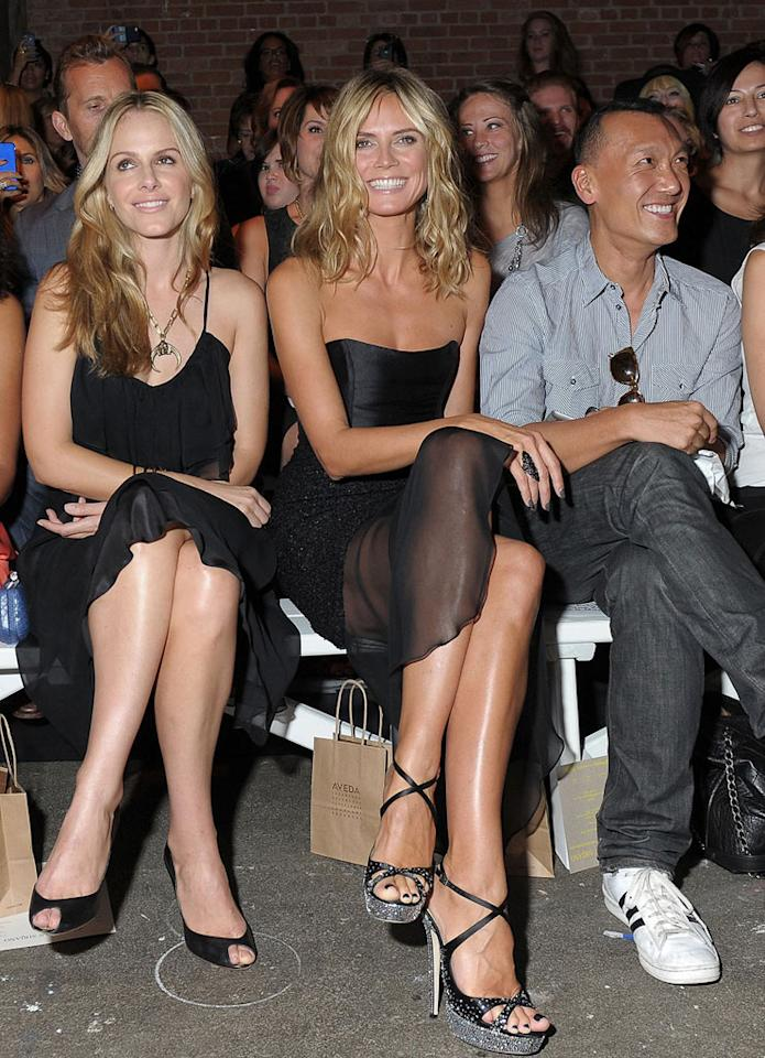 "Heidi Klum was all smiles as she sat between actress Monet Mazur and <i>Elle</i> magazine creative director Joe Zee at the Christian Siriano show on Saturday. The ""Project Runway"" hostess has a special connection with Christian -- he won season 4 of the reality competition series. Michael Loccisano/<a href=""http://www.gettyimages.com/"" target=""new"">GettyImages.com</a> - September 10, 2011"