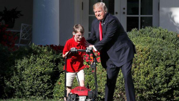 PHOTO: Frank Giaccio, 11, of Falls Church, Va., left, is encouraged by President Donald Trump, Sept. 15, 2017, while he mowed the lawn in the Rose Garden at the White House in Washington. (Jacquelyn Martin/AP)