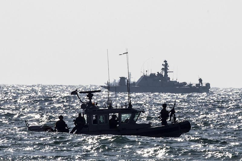 A picture taken from the southern Israeli border with the Gaza Strip on July 9, 2014, shows Israeli navy vessels patrolling the Mediterranean Sea (AFP Photo/Jack Guez)