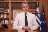 Greek Prime Minister Kyriakos Mitsotakis announces new coronavirus disease (COVID-19) related restrictions at Maximos mansion in Athens