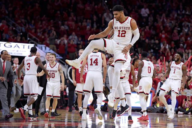 "Allerik Freeman #12 of the North Carolina State Wolfpack celebrates with teammates following a play against the <a class=""link rapid-noclick-resp"" href=""/ncaab/teams/dau/"" data-ylk=""slk:Duke Blue Devils"">Duke Blue Devils</a> at PNC Arena on January 6, 2018 in Raleigh, North Carolina. (Getty Images)"