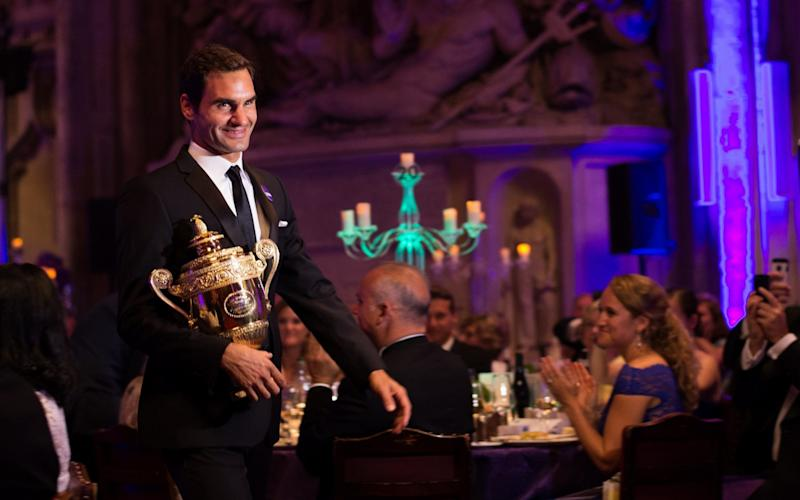 Federer attended the traditional champions' dinner - Credit: GETTY IMAGES