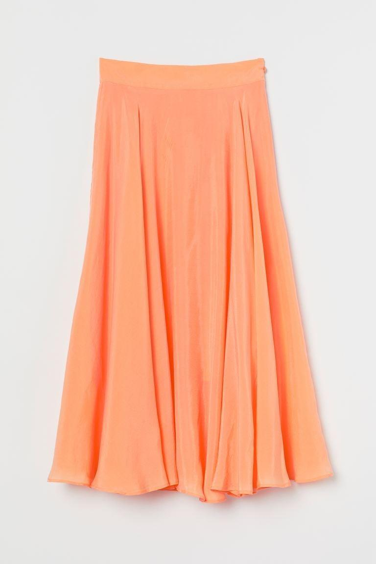 "<p>We love the sherbet-orange shade of this <a href=""https://www.popsugar.com/buy/HampM-Circle-Skirt-580544?p_name=H%26amp%3BM%20Circle%20Skirt&retailer=www2.hm.com&pid=580544&price=60&evar1=fab%3Aus&evar9=47523854&evar98=https%3A%2F%2Fwww.popsugar.com%2Ffashion%2Fphoto-gallery%2F47523854%2Fimage%2F47538038%2FHM-Circle-Skirt&list1=shopping%2Ch%26m%2Csummer%20fashion%2Cfashion%20shopping&prop13=mobile&pdata=1"" class=""link rapid-noclick-resp"" rel=""nofollow noopener"" target=""_blank"" data-ylk=""slk:H&amp;M Circle Skirt"">H&amp;M Circle Skirt </a> ($60).</p>"