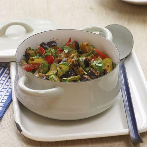 "<p>Spend 20 minutes preparing this dish before you let the <a href=""https://www.goodhousekeeping.com/uk/product-reviews/electricals/g25900206/best-slow-cookers-reviewed/"" rel=""nofollow noopener"" target=""_blank"" data-ylk=""slk:slow cooker"" class=""link rapid-noclick-resp"">slow cooker</a> do the rest of the work. Start by softening the onions and garlic before adding to your <a href=""https://www.goodhousekeeping.com/uk/food/recipes/g538754/best-slow-cooker/"" rel=""nofollow noopener"" target=""_blank"" data-ylk=""slk:slow cooker"" class=""link rapid-noclick-resp"">slow cooker</a>, and fry the aubergines, <a href=""https://www.goodhousekeeping.com/uk/food/recipes/g25934105/tasty-courgette-summer-recipes/"" rel=""nofollow noopener"" target=""_blank"" data-ylk=""slk:courgettes"" class=""link rapid-noclick-resp"">courgettes</a>, tomatoes and sliced peppers for two to three minutes before adding them in too. Cook in the slow cooker for four hours and serve with rice. </p><p><strong>Recipe: <a href=""https://www.goodhousekeeping.com/uk/food/recipes/a537052/slow-cooker-ratatouille/"" rel=""nofollow noopener"" target=""_blank"" data-ylk=""slk:Slow Cooker Ratatouille"" class=""link rapid-noclick-resp"">Slow Cooker Ratatouille</a></strong></p>"