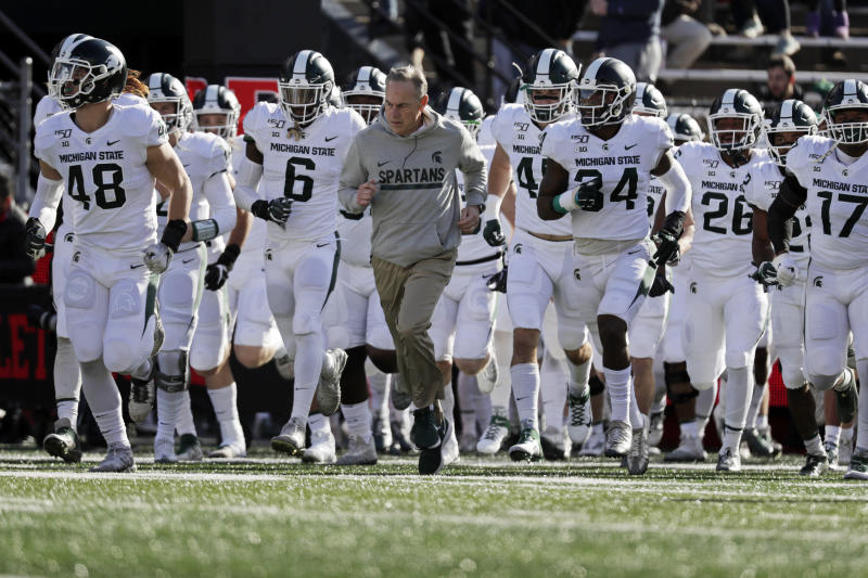 Michigan State head coach Mark Dantonio leads his team on to the field to face Rutgers in an NCAA college football game Saturday, Nov. 23, 2019, in Piscataway, N.J. Michigan State won 27-0. (AP Photo/Adam Hunger)