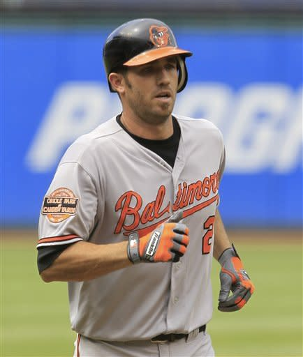 Baltimore Orioles' J.J. Hardy runs the bases after hitting a two-run home run off Cleveland Indians starting pitcher Josh Tomlin in the first inning in a baseball game, Sunday, July 22, 2012, in Cleveland. Nick Markakis scored. (AP Photo/Tony Dejak)