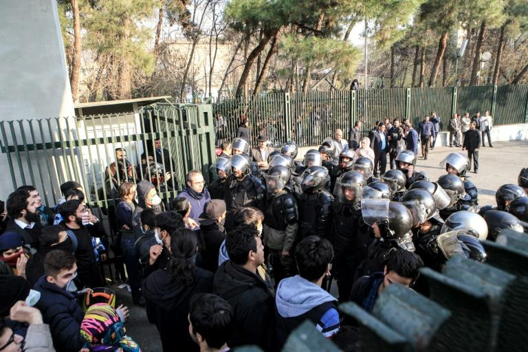 As protests persist, Rouhani warns Iran will respond to 'lawbreakers'