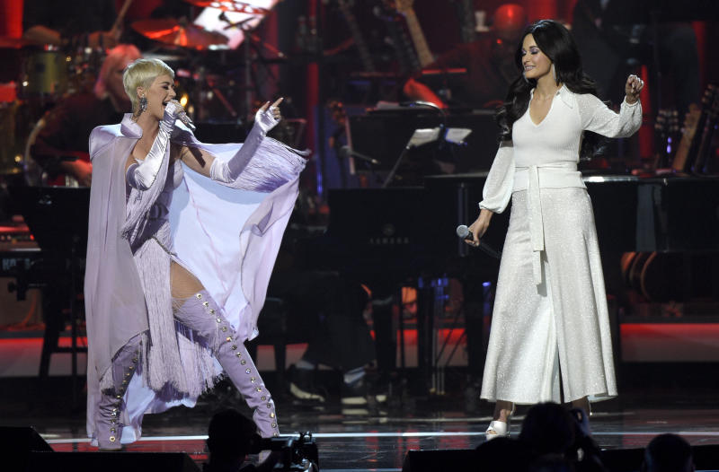 "CORRECTS YEAR TO 2019 - Katy Perry, left, and Kacey Musgraves perform ""Here You Come Again"" at MusiCares Person of the Year honoring Dolly Parton on Friday, Feb. 8, 2019, at the Los Angeles Convention Center. (Photo by Chris Pizzello/Invision/AP)"