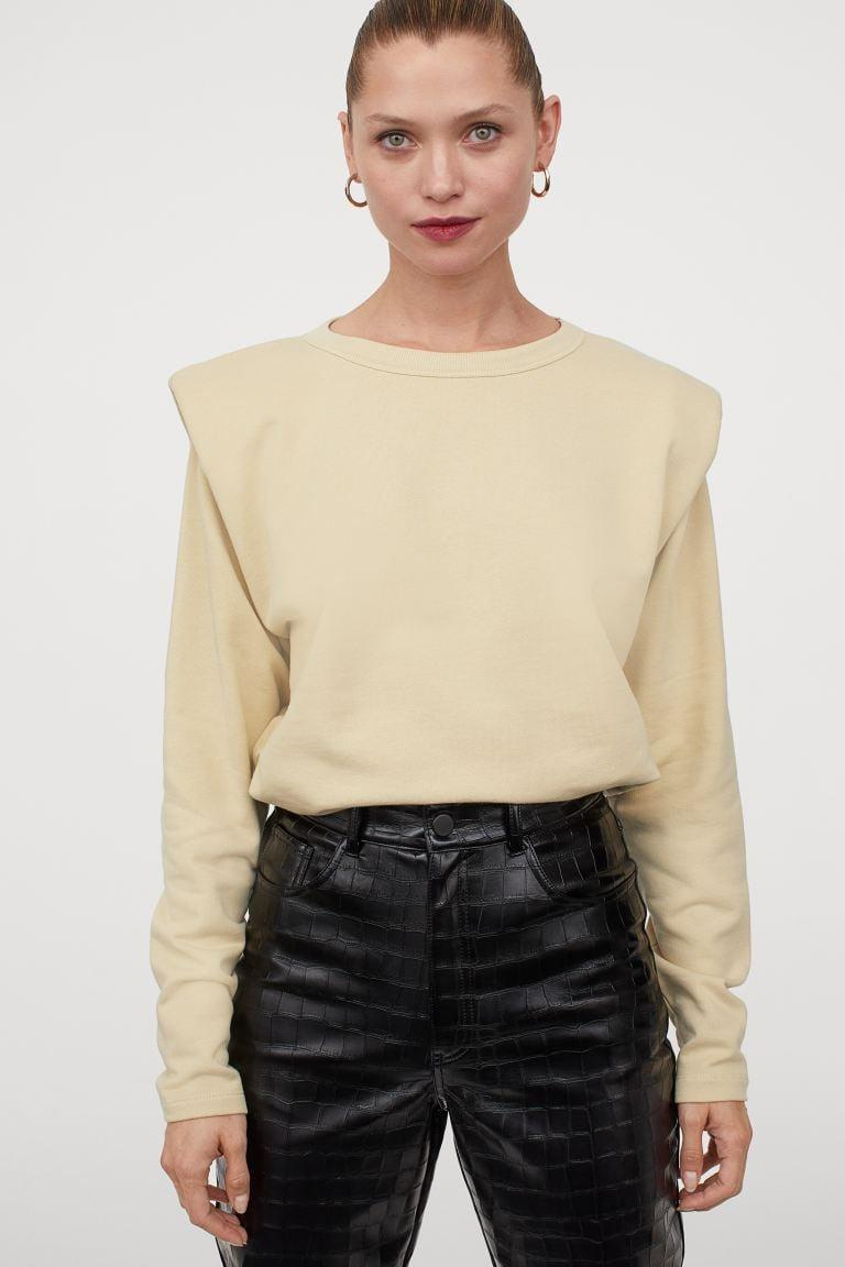 """<p>""""I'm extending my shoulder-pad obsession straight into fall thanks to this <span>H&M Shoulder-pad Sweatshirt</span> ($35). I love that it's comfortable enough to wear at home, stylish for conference calls, and neutral passing to pair with my wide array of sweatpants and leggings."""" - SN</p>"""