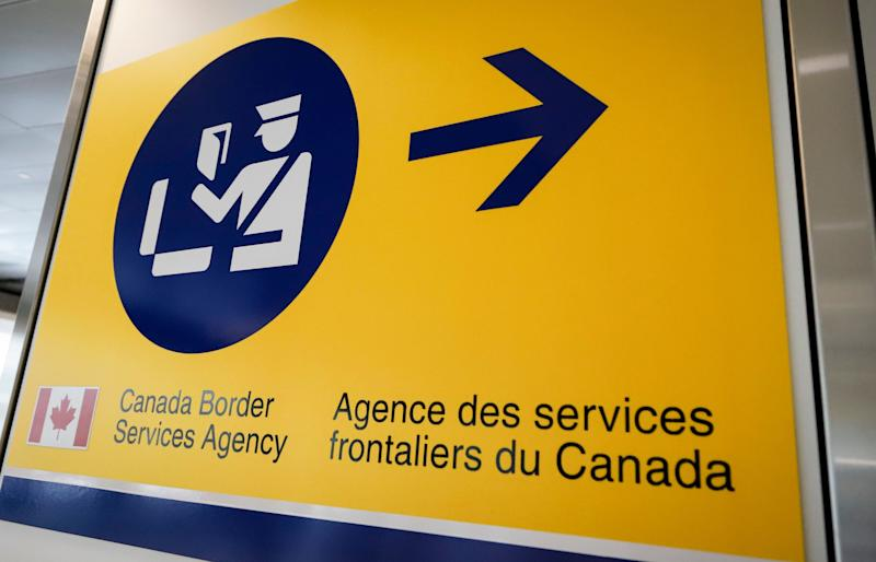 Approximately 13 in every 100,000 travellers have had their digital devices examined by border agents, the CBSA says. (Photo: Jeff McIntosh/CP)
