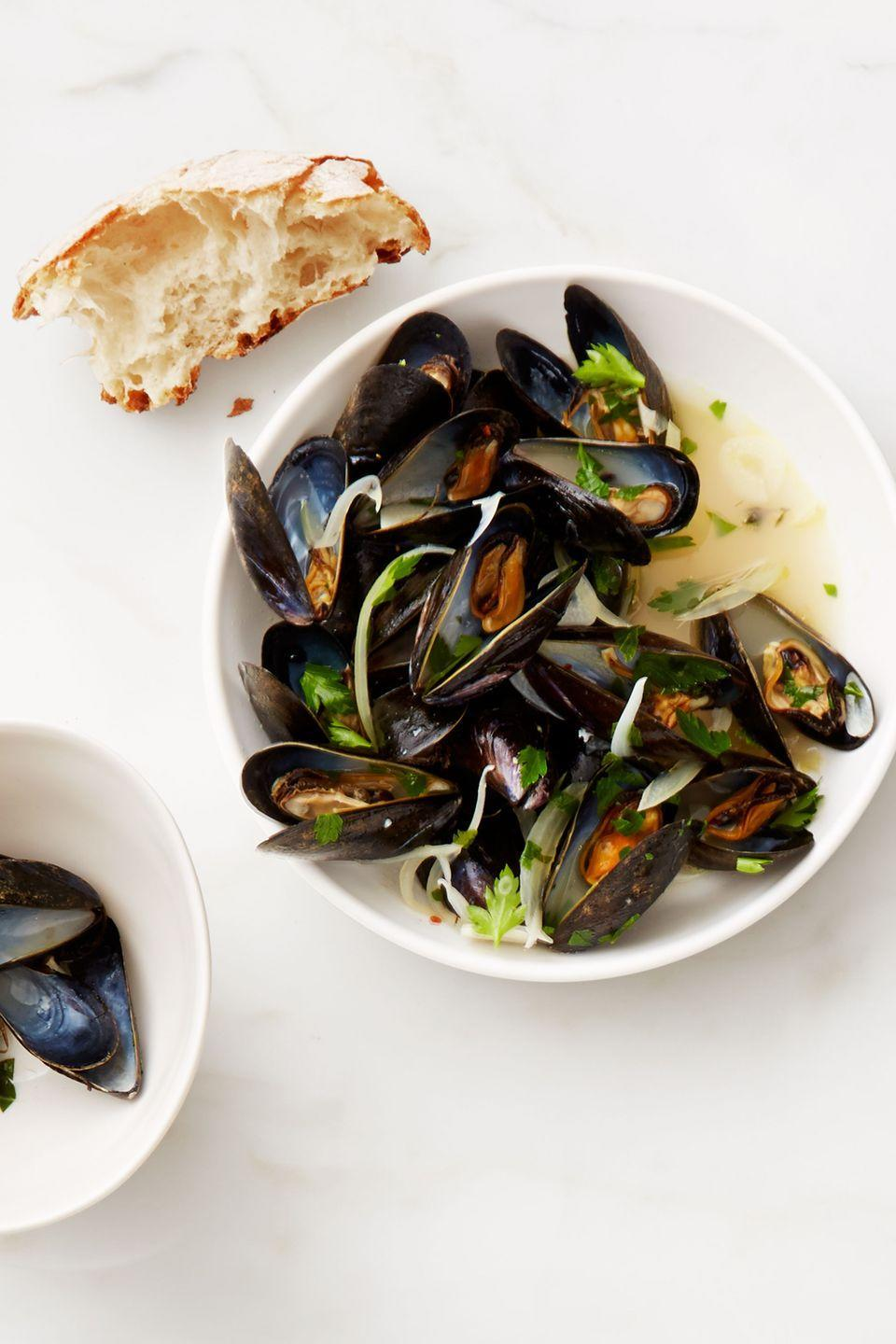 "<p>Now you can eat mussels whenever you want, not just in restaurants or on vacations. Plus, each serving clocks in at less than 200 calories. </p><p><a href=""https://www.womansday.com/food-recipes/food-drinks/recipes/a53285/white-wine-mussels/"" rel=""nofollow noopener"" target=""_blank"" data-ylk=""slk:Get the White Wine Mussels recipe."" class=""link rapid-noclick-resp""><em><strong>Get the White Wine Mussels recipe.</strong></em></a></p>"