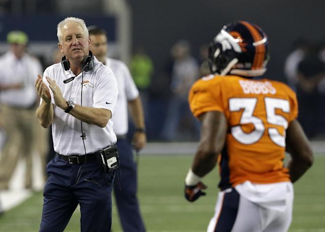 Denver Broncos head coach John Fox applauds running back Kapri Bibbs (35) after Bibbs scored a touchdown against the Dallas Cowboys in the second half of a NFL preseason football game, Thursday, Aug. 28. 2014, in Arlington, Texas. (AP Photo/LM Otero)