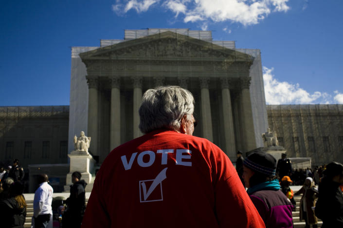 People gather outside the Supreme Court in Washington on Feb. 27, 2013, to await the ruling in Shelby County v. Holder. (Christopher Gregory/The New York Times)