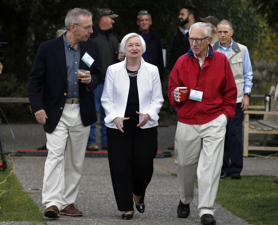 FILE - In this Aug. 26, 2016, file photo Federal Reserve Chair Janet Yellen, center, walks with Stanley Fischer, right, vice chairman of the Board of Governors of the Federal Reserve System, and Bill Dudley, the president of the Federal Reserve Bank of New York, before Yellen's speech to the annual invitation-only conference of central bankers from around the world, at Jackson Lake Lodge in Grand Teton National Park, north of Jackson Hole, Wyo. (AP Photo/Brennan Linsley, File)