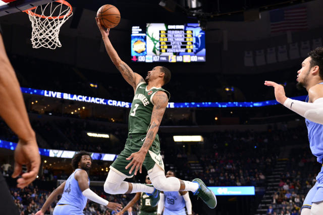 Milwaukee Bucks guard George Hill (3) shoots against the Memphis Grizzlies in the second half of an NBA basketball game Friday, Dec. 13, 2019, in Memphis, Tenn. (AP Photo/Brandon Dill)