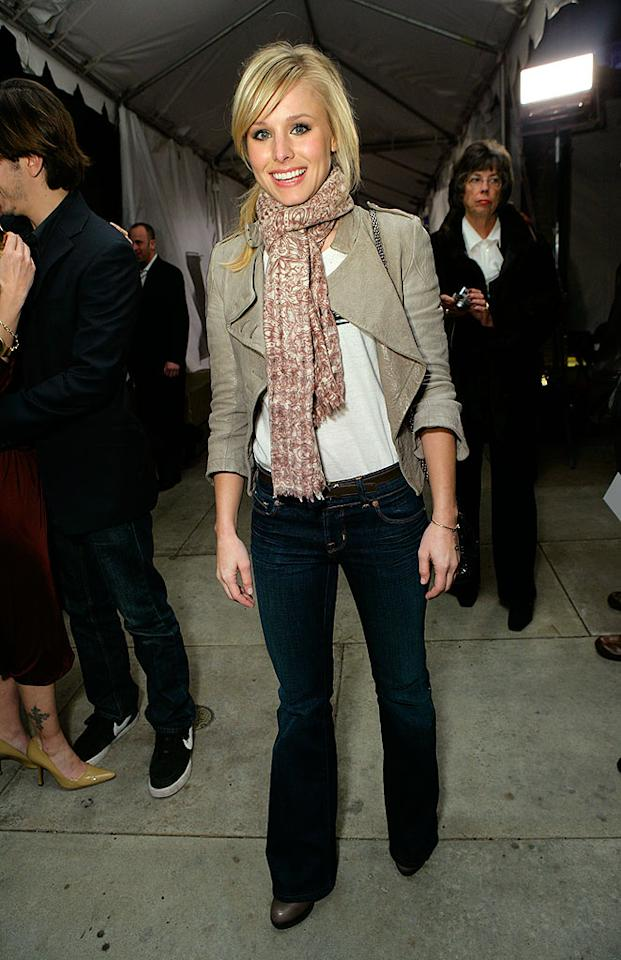 "Kristen Bell looks appropriately dressed for a ""Wild West"" show in sexy dark denim jeans and a light brown leather jacket. Todd Williamson/<a href=""http://www.wireimage.com"" target=""new"">WireImage.com</a> - January 28, 2008"