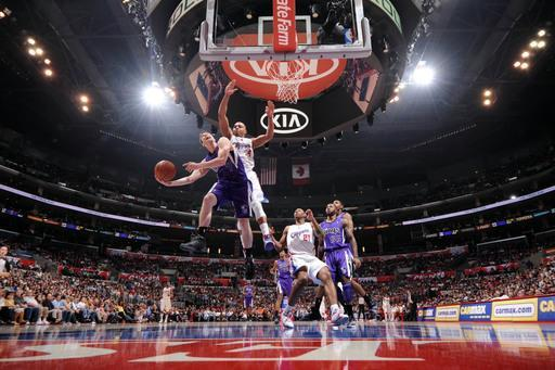 LOS ANGELES, CA - APRIL 7: Jimmer Fredette #7 of the Sacramento Kings avoids contact from Randy Foye #4 of the Los Angeles Clippers while attempting a shot at Staples Center on April 7, 2012 in Los Angeles, California. (Photo by Noah Graham/NBAE via Getty Images)