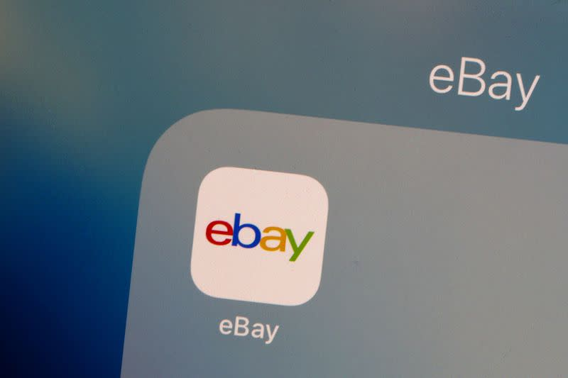 The eBay logo is pictured on a phone screen in this photo illustration in New York
