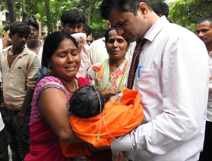 This file photo taken on August 12, 2017 shows relatives mourning the death of a child at the Baba Raghav Das Hospital in Gorakhpur, in the northern Indian state of Uttar Pradesh (AFP Photo/-)