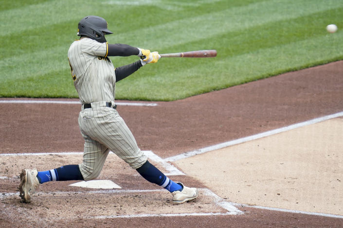 San Diego Padres' Eric Hosmer drives in two runs with a bases loaded single against the Pittsburgh Pirates in the second inning of a baseball game, Thursday, April 15, 2021, in Pittsburgh. (AP Photo/Keith Srakocic)